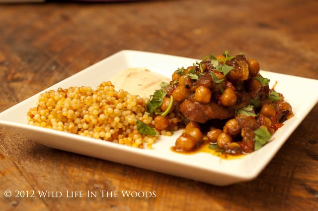 Chicken and Chickpea Tagine with Apricots and Harissa Sauce is so delicious! Go on an adventure in eating to Morocco, for the price of a few spices! #chicken #tagine #Morocco #apricots