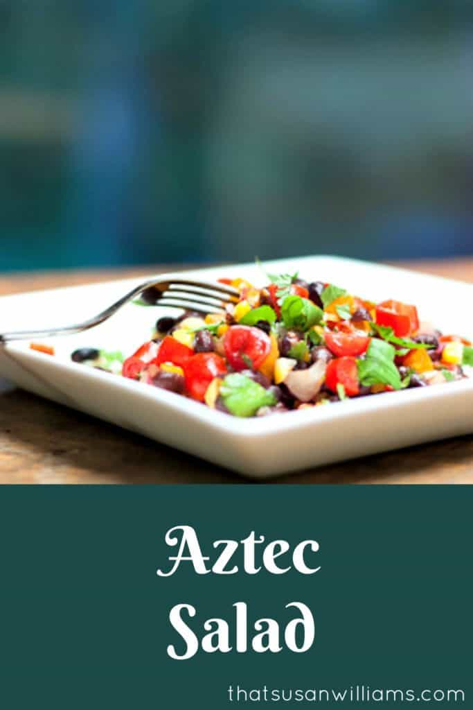 Aztec Salad is the perfect side dish for grilling out, or a light, tasty, healthy vegetarian lunch. A veggie salad with plenty of protein. #salad #healthy #easy #blackbeans #corn #tomatoes