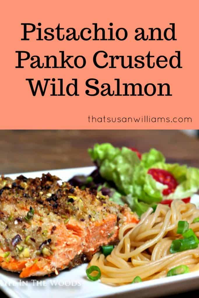 Pistachio and Panko Crusted Salmon on a plate with sesame noodles and tossed salad.