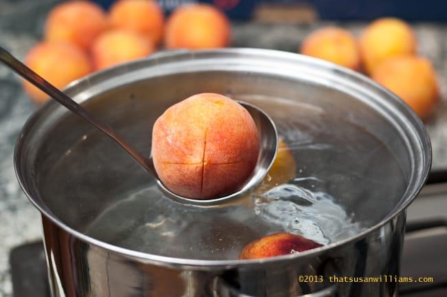 Cut an X on the peaches