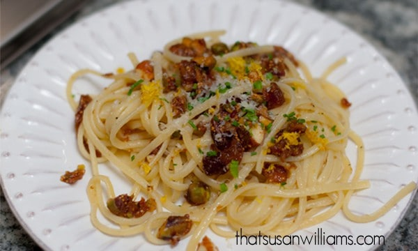 A vegetarian pasta with browned butter, dried fruits and nuts.