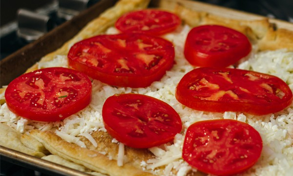 Puff pastry, mozzarella cheese, and salted tomatoes.