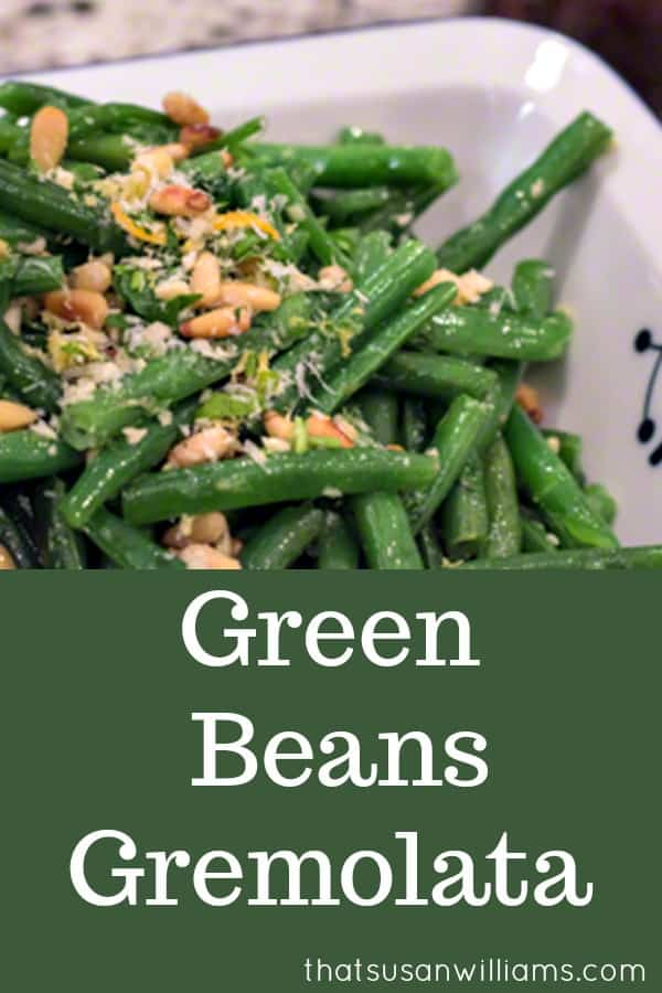My favorite holiday side dish, whether for #Easter, #Thanksgiving or #Christmas, these green beans are cooked crisp-tender, and have a gremolata topping of #pinenuts, #lemonzest, and #garlic. #HolidaySideDish #GreenBeans