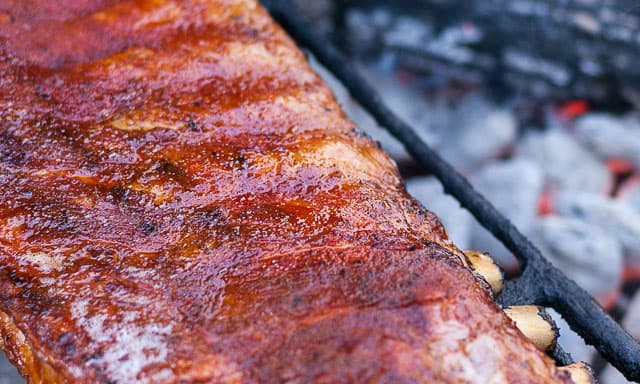 Slap yo' Mama Ribs, with delicious Slap yo' Mama Rib Rub, are started in the oven and finished on the grill, with a little smoke.