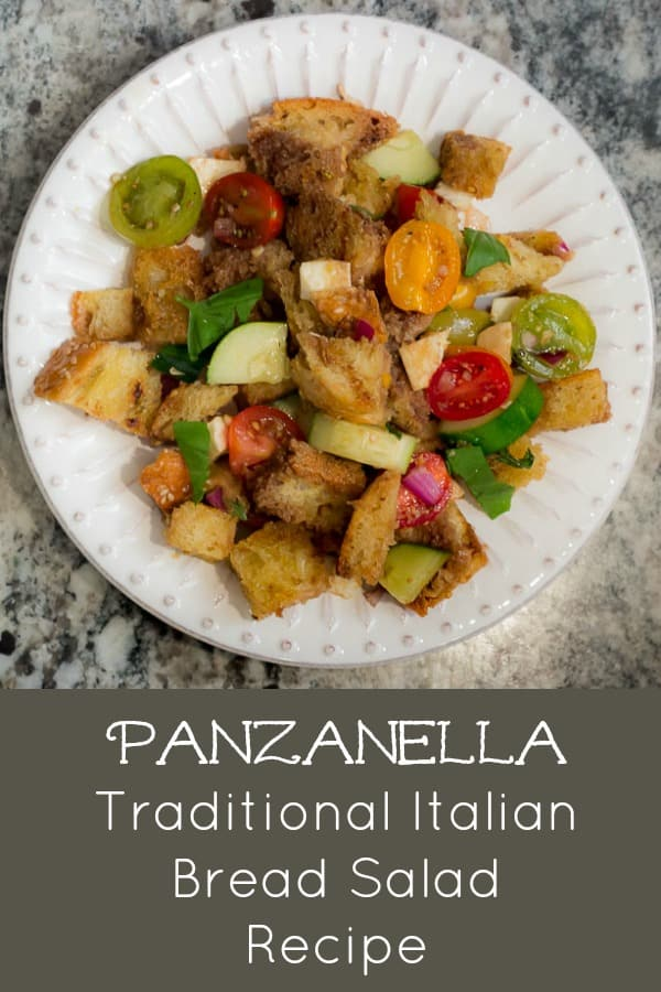 Panzanella is SCRUMPTIOUS! It's a traditional Italian bread salad recipe, and the best use of fresh summer tomatoes, fresh mozzarella, basil, and a balsamic vinaigrette I know! #panzanella #Italian #breadsalad #tomatoes #summersalad
