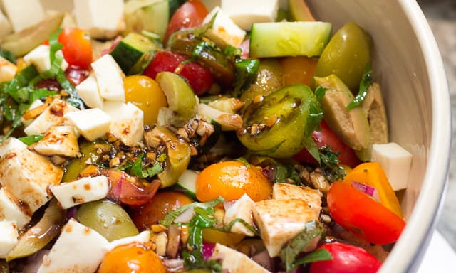 Panzanella is SCRUMPTIOUS! It's a traditional Italian bread salad recipe, and the best use of fresh summer tomatoes, fresh mozzarella, basil, and a balsamic vinaigrette I know!