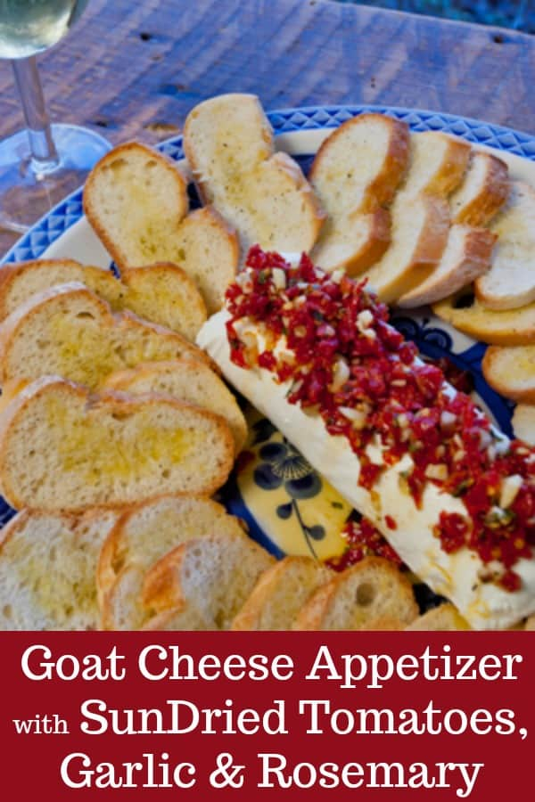 A holiday appetizer that's quick, easy, beautiful, and amazingly delicious! Goat Cheese with Sun-Dried Tomatoes, Garlic, and Rosemary on Crostini. Perfect for Christmas parties, too! #Thanksgiving #appetizer #holiday #cheese #chèvre #goatcheese #cheesebal
