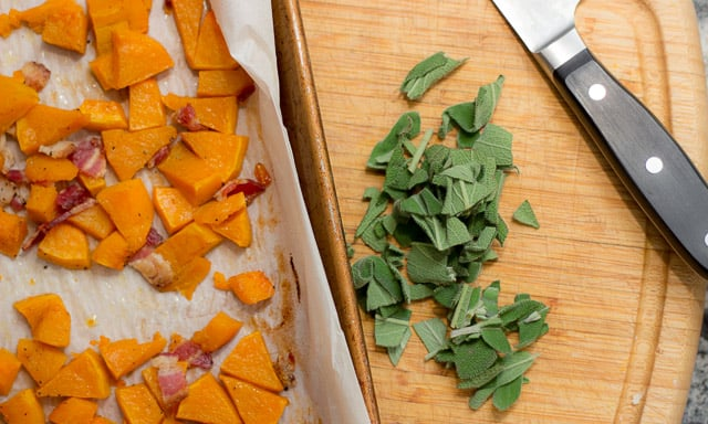 This fall recipe for roasted butternut squash with pine nuts, sage, and browned butter is the perfect comfort food for a cozy autumn evening. #ButternutSquash #bacon #sage