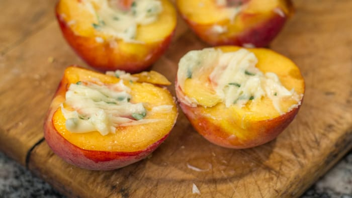 Peaches spread with herbed honey butter