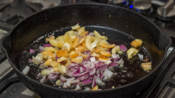 Sautéing the onions and peppers for Savory Summer Squash Pie
