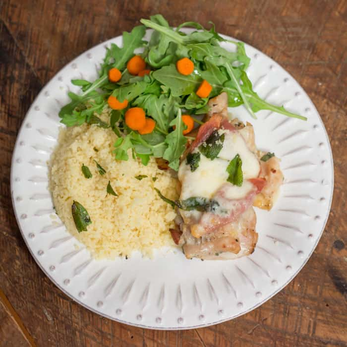 Chicken Saltibocca, served with couscous, and an arugula salad