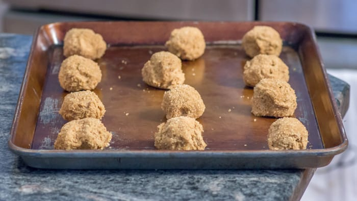 Cookie dough balls ready for the oven.