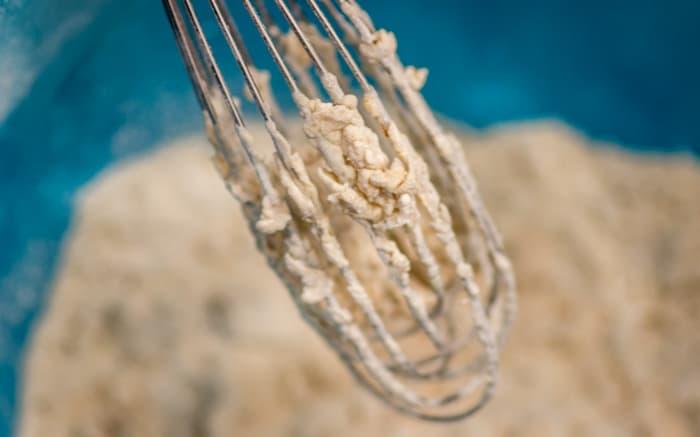 When you pour the buttermilk into the flour and spice mixture, little craggy bits develop.