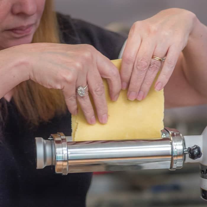 After the first pass through the machine, fold your dough into thirds, and then feed it through the widest setting of the roller again, a few more times.