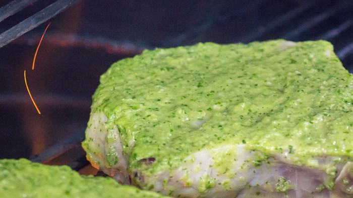 When you first put the pork chops on the grill, the top side will still have that bright, vibrantly colored marinade.