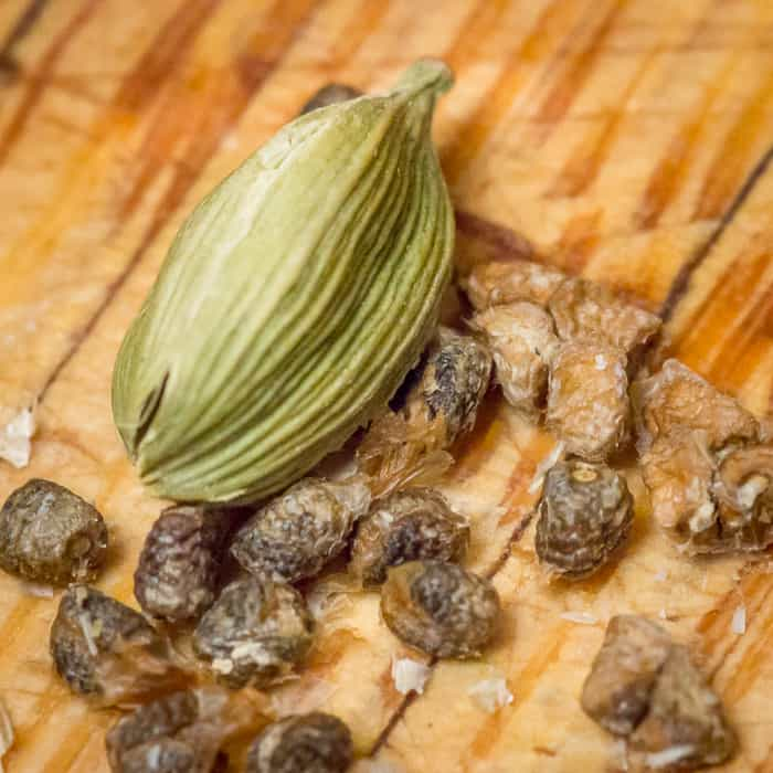 The green cardamom pod, when smashed open, holds brown cardamom seeds.